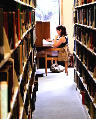 Image of a person studying at a desk